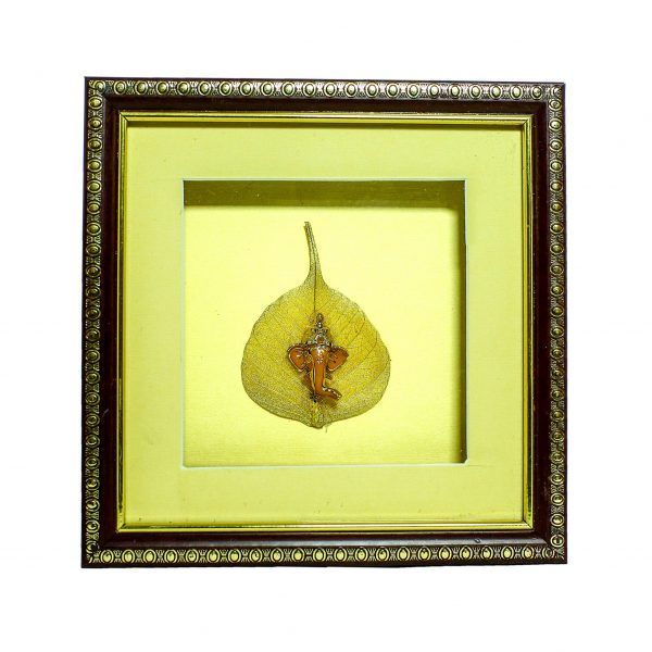 Frame with beautiful statue of Ganpati embedded on gold plated peepal leaf