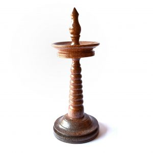 Traditional lamp of Kerala made in wood of coconut tree